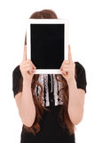 Girl keeps tablet pc in front of face Stock Photo