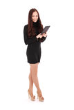 Girl keeps tablet pc standing sideways. Isolated on white Royalty Free Stock Image