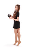 Girl keeps tablet pc standing sideways. Isolated on white Stock Photography
