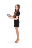 Girl keeps tablet pc standing sideways Royalty Free Stock Photos