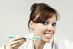 Girl keeps a toothbrush Stock Photography