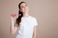Girl keeps a toothbrush and smiles Stock Image