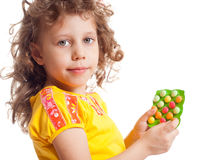 The girl keeps vitamins. In packages Royalty Free Stock Photos