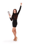 Girl keeps white tablet pc standing sideways. Isolated on white Royalty Free Stock Photography