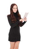 Girl keeps white tablet pc standing sideways Stock Image