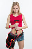 Girl. keeps working tools. hammer royalty free stock photos