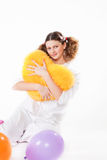 Girl keeps a yellow pillow Royalty Free Stock Images