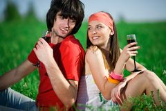 Girl in kerchief and boy with wineglasses Stock Photos