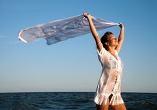 Girl with kerchief on the sunset Stock Image