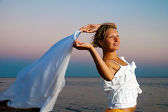 Girl with kerchief on the sunset Royalty Free Stock Photography