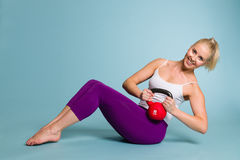 Girl and kettlebell Royalty Free Stock Image
