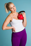 Girl and kettlebell Royalty Free Stock Photography