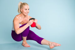 Girl and kettlebell Royalty Free Stock Images