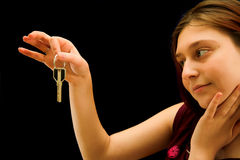 Girl with key Stock Image