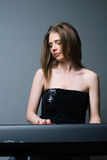 Girl with keyboard Royalty Free Stock Photography