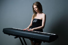 Girl with keyboard Royalty Free Stock Image