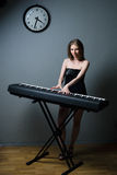 Girl with keyboard Royalty Free Stock Images
