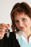 Girl with keys. Caucasian teenage girl with happy smiling facial expression with keys Royalty Free Stock Photography