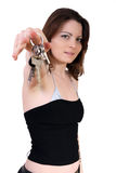 Girl with keys. Young girl holding the keys of car and house Royalty Free Stock Photo
