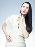 Girl with keys. Long-haired brunette girl with keys Royalty Free Stock Photos