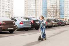 Girl on a kick scooter. Royalty Free Stock Image
