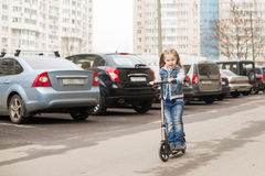Girl on a kick scooter. Stock Image
