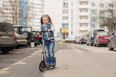 Girl on a kick scooter. Stock Photography