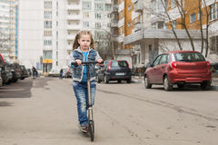 Girl on a kick scooter. Royalty Free Stock Photos