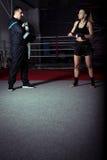 Girl kicking back leg during kickboxing practice Stock Photo