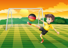A girl kicking the ball with the flag of Germany Stock Images