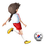 A girl kicking the ball with the South Korean flag Royalty Free Stock Photography