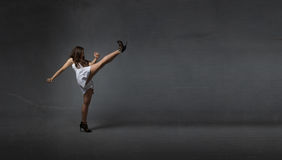 Girl kicking empty space Stock Photos