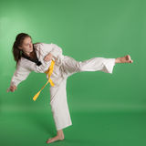 Girl kicking Stock Photos