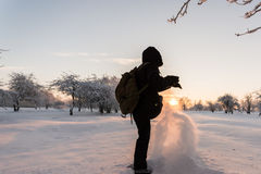 Girl kicking snow. Winter landscape. Sunset. Stock Image