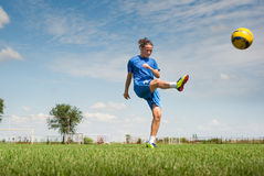 Girl kicking soccer ball Stock Photo