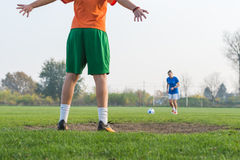 Girl kicking soccer ball Royalty Free Stock Image