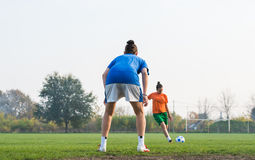 Girl kicking soccer ball Royalty Free Stock Photography