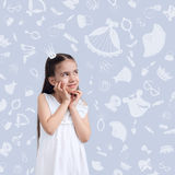 Girl kid on background of texture of girl's things Royalty Free Stock Image