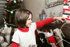 Girl Kid Decorating Home for Christmas Royalty Free Stock Photo