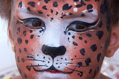 Girl kid face with panther mask 4. Cute girl kid face with painted panther color mask Royalty Free Stock Images