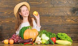 Girl kid farm market with fall harvest. Child celebrate harvesting. Kid farmer with harvest wooden background. Family stock photo