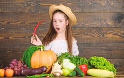 Girl kid farm market with fall harvest. Kid farmer with harvest wooden background. Family farm festival concept. Farm stock images