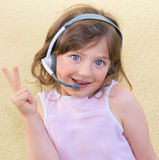 Girl, kid, headset. Royalty Free Stock Photography
