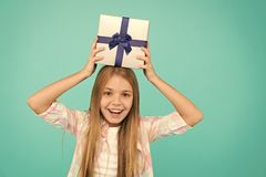Girl kid hold birthday gift box. Every kid dream about such surprise. Birthday girl carry present. Making gifts stock image
