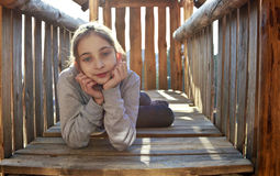 Girl in kid house on playground Stock Images