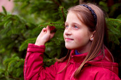 Girl kid looking and posing near the green tree Royalty Free Stock Photography