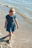 Girl kid walk water sea Royalty Free Stock Image