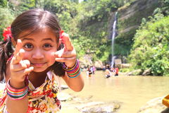 Girl kidding. Girl playing and kidding in front of water fall Royalty Free Stock Photo