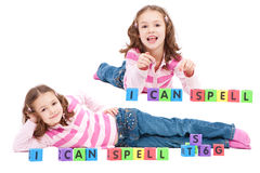 Girl with kids blocks saying I can spell collage Royalty Free Stock Photography