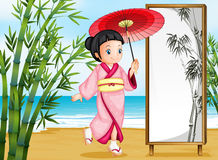 A girl in a kimono attire Royalty Free Stock Images